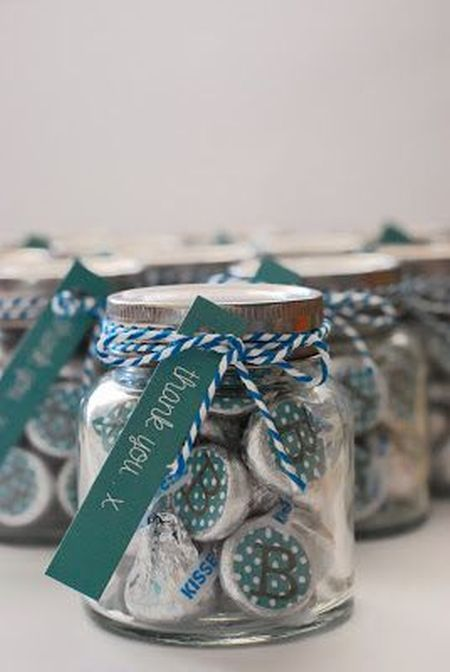 Clear jars filled with color coordinated Hershey Kisses and thank ...