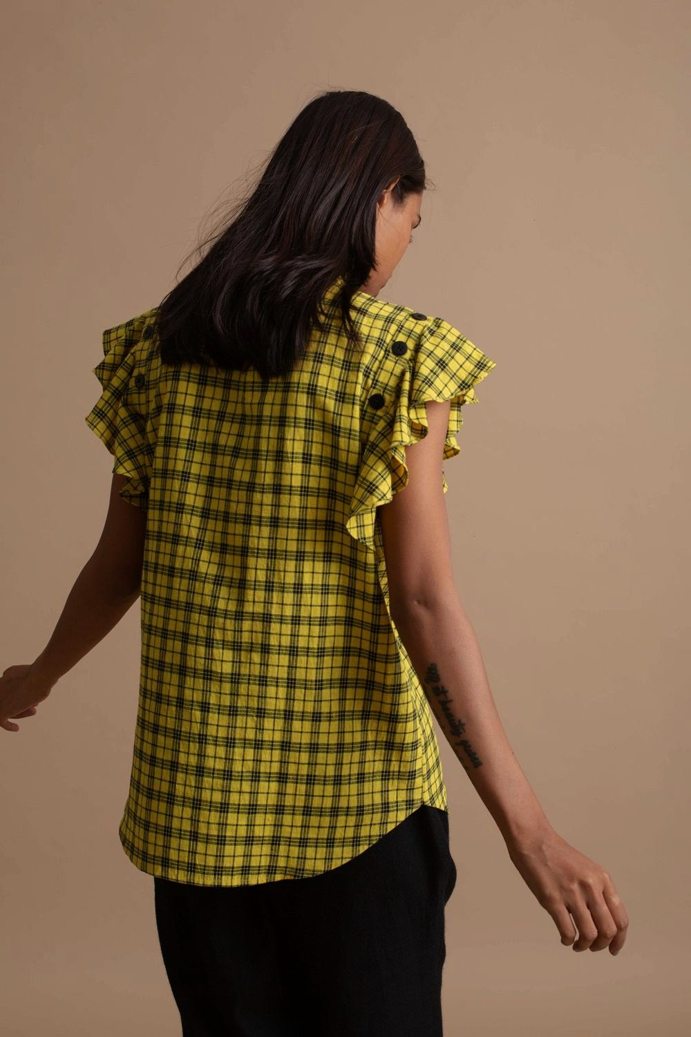 Sleeve Top from Kanelle The Detachable Sleeve top is crafted from handspin cotton in a yellow and black checkered pattern The straight fit top comes with detachable frill...