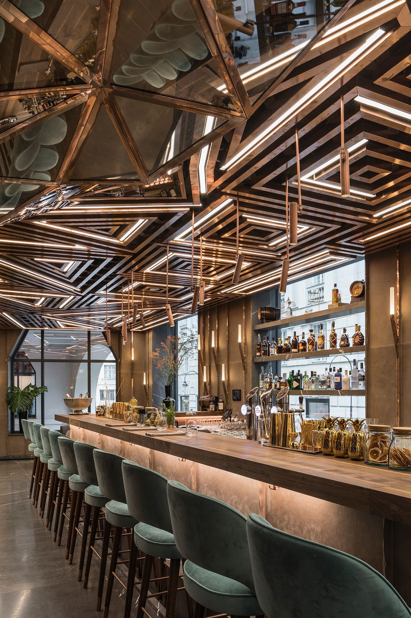 Luxury bar design featuring geometric brass ceiling panels and ...