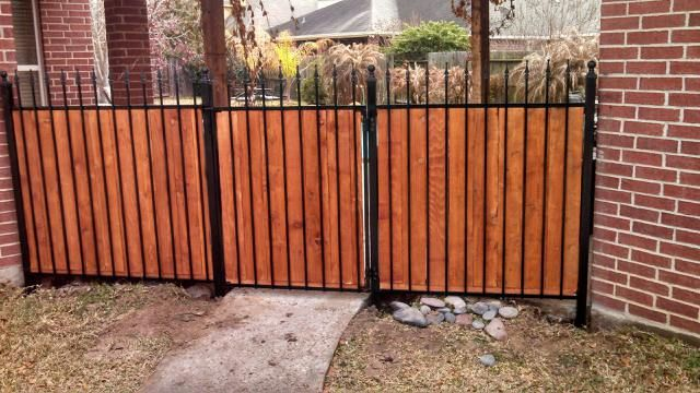Really Cool Wrought Iron And Cedar Privacy Fence From Houston Quality Fenicng Http Www Woodlandsfence Com Wood Privacy Fence Fence Design Iron Fence