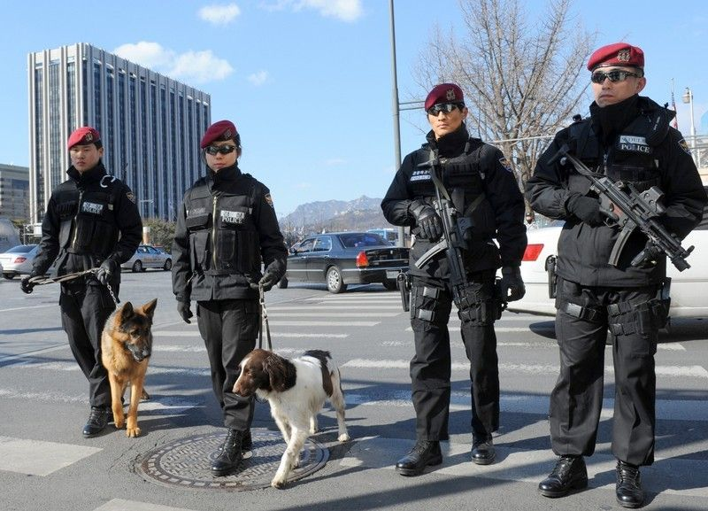 South Korean police SWAT team members stand guard outside