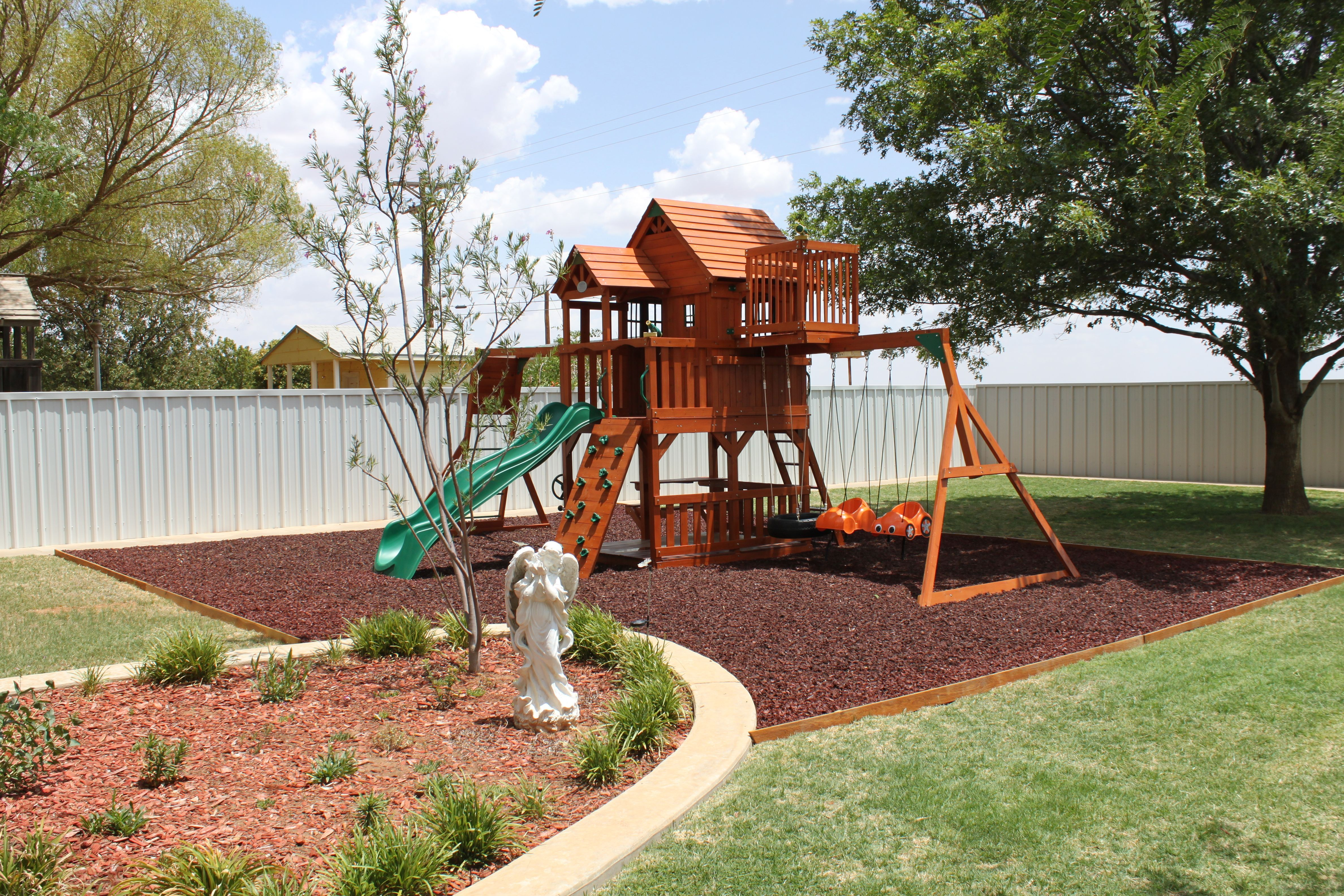 Rubber mulch in home playground and landscape surfacing!