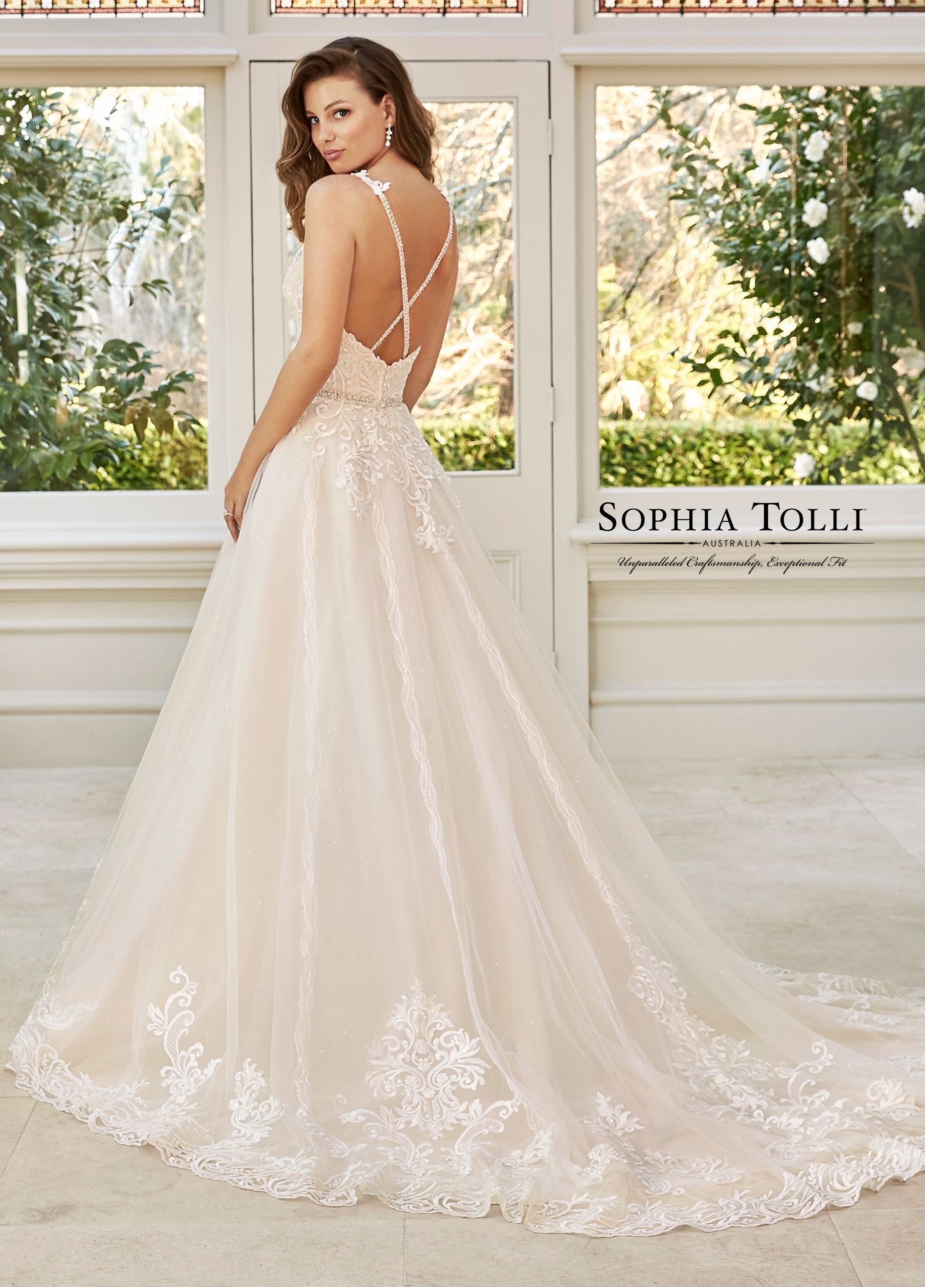 ... McKenna – With a high scoop sheer illusion neckline. Beaded criss-cross  back straps and beaded belt frames the waist perfectly. Misty sparkle tulle  ... 668bc70e5a1e