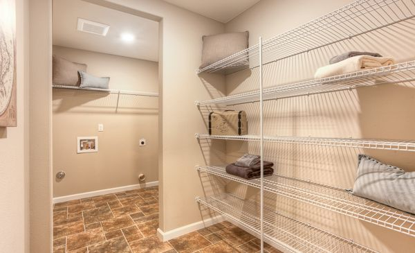 Laundry room and laundry shelved laundry storage area in