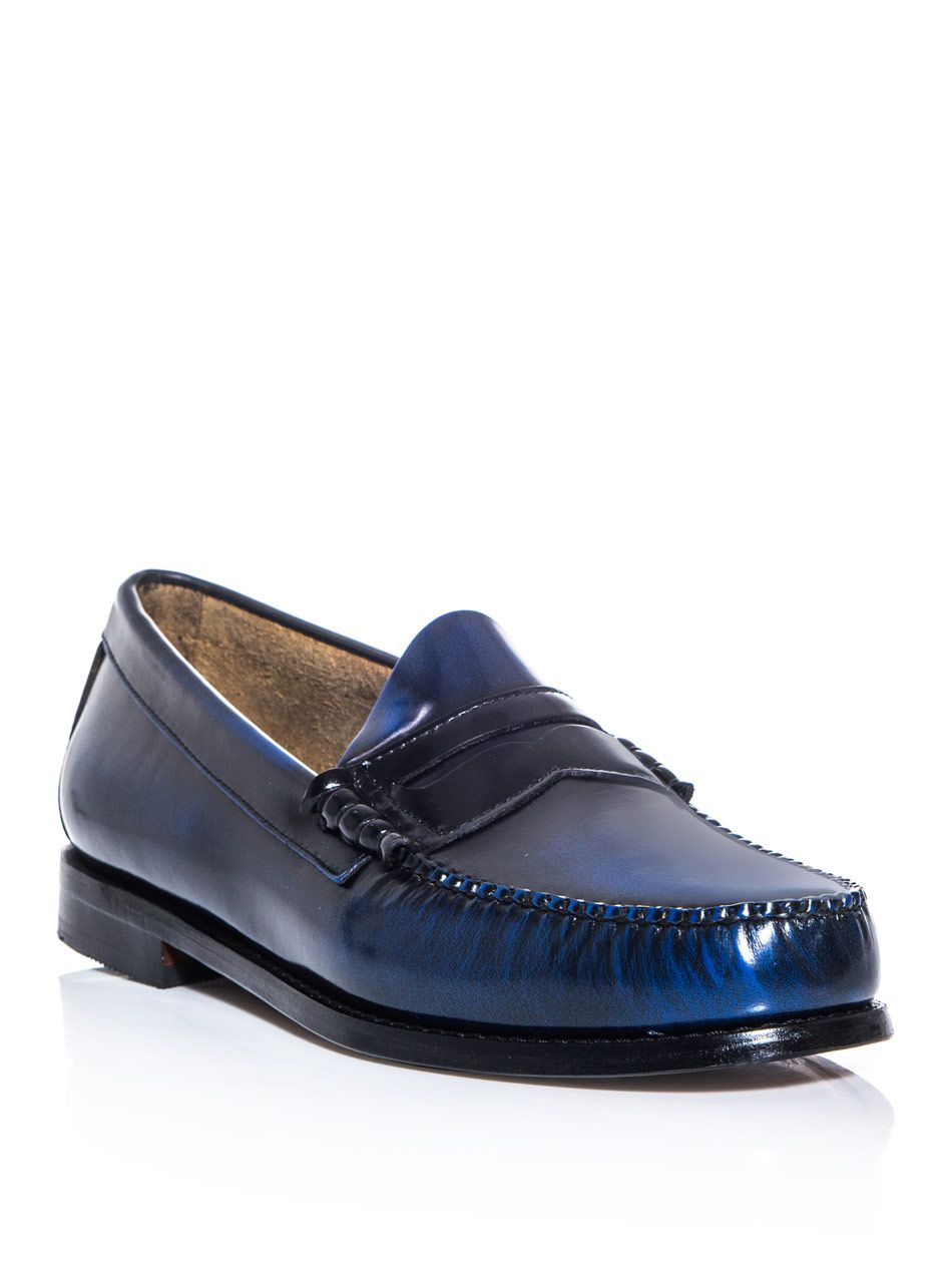 Round-toe Penny loafers cut from a blue and black burnished leather. Bass  Weejuns