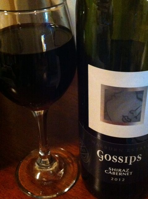 Wine Review: Warburn Estate 2012 Gossips Shiraz Cabernet:   This young, full-bodied red is both cheap to buy and enjoyable to drink. From South Eastern Australia it is smooth, with tastes of berries, fruitcake and spice.  Not overly strong on the nose, it is pleasant to drink with grilled vegetables, braised meats and stews, and Cheddar cheese. This Shiraz Cab goes down very well now or it can be cellared for a year or three.  7 out of 10