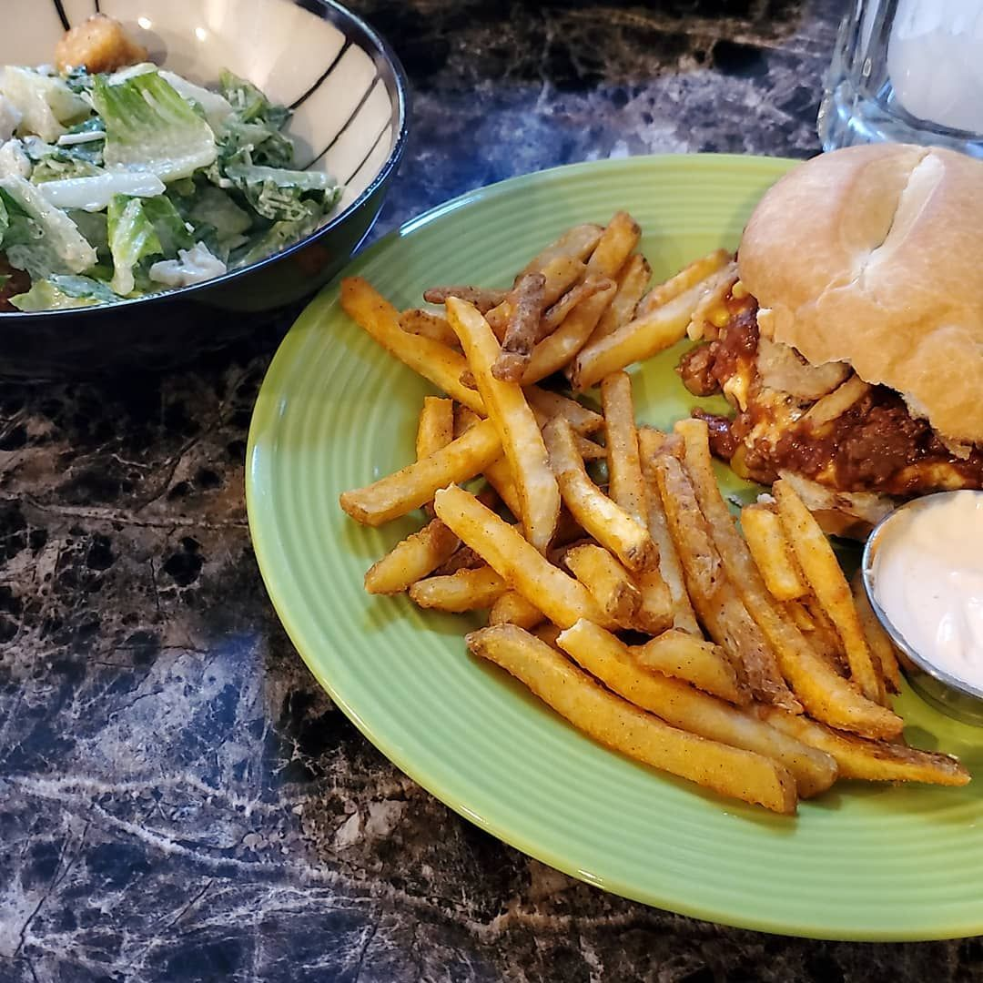 Impossible chilli cheeseburger & fries with sriracha aioli and a cesar salad. . . .
