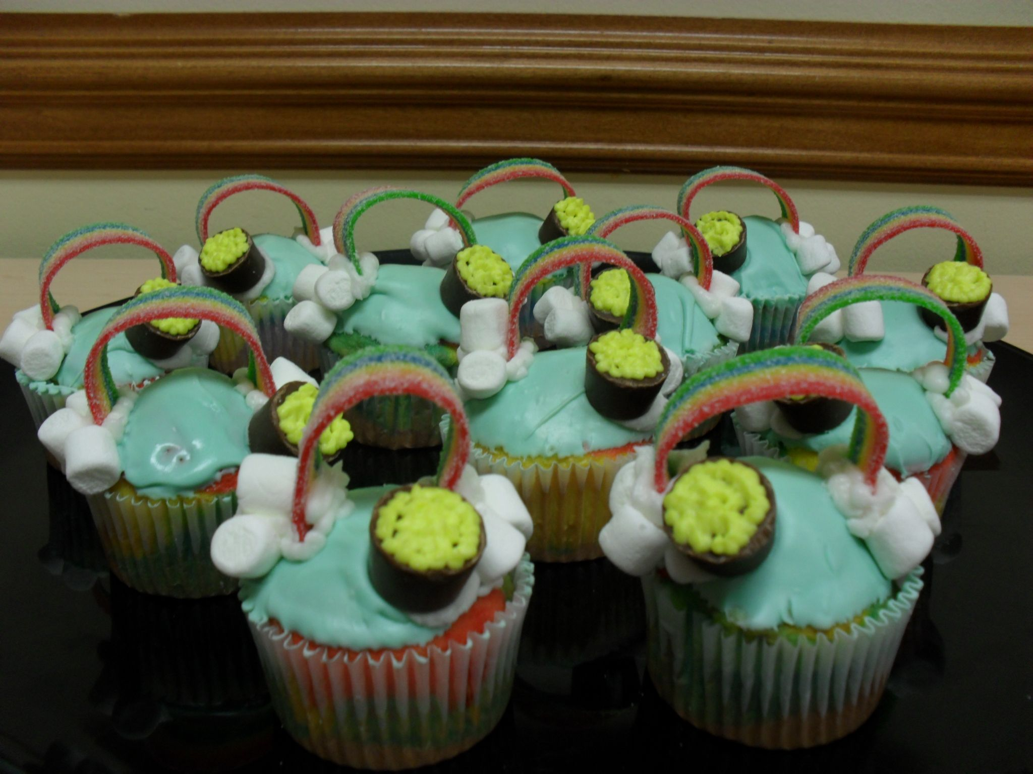 Rainbow cupcakes for St. Patrick's Day!!! And yes... it is rainbow cake underneath!