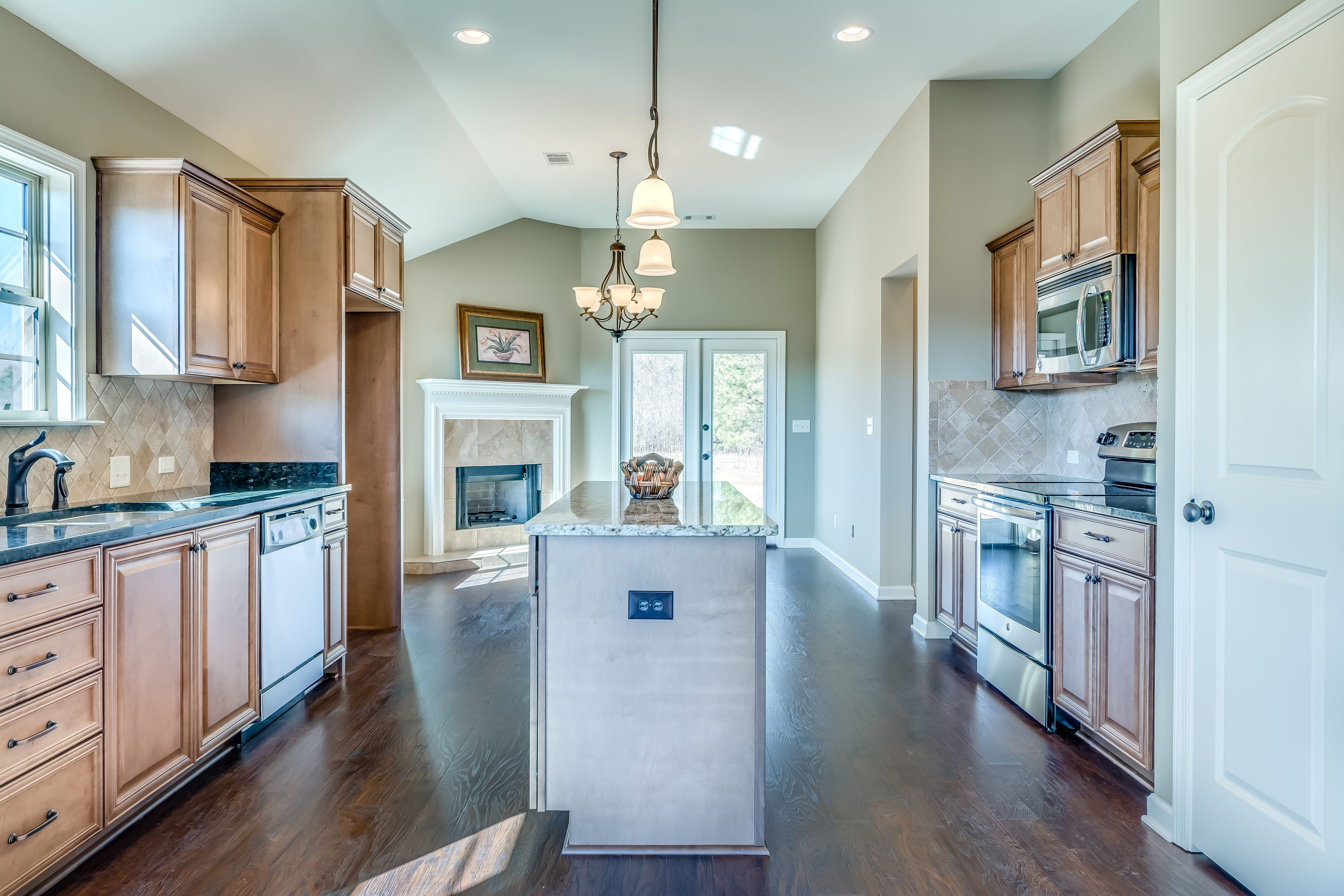 Beautiful kitchen with stainless steel appliances, granite countert ...