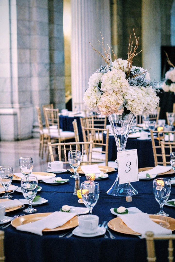 Navy and gold wedding tablescape at the old cleveland for Golden wedding table decorations