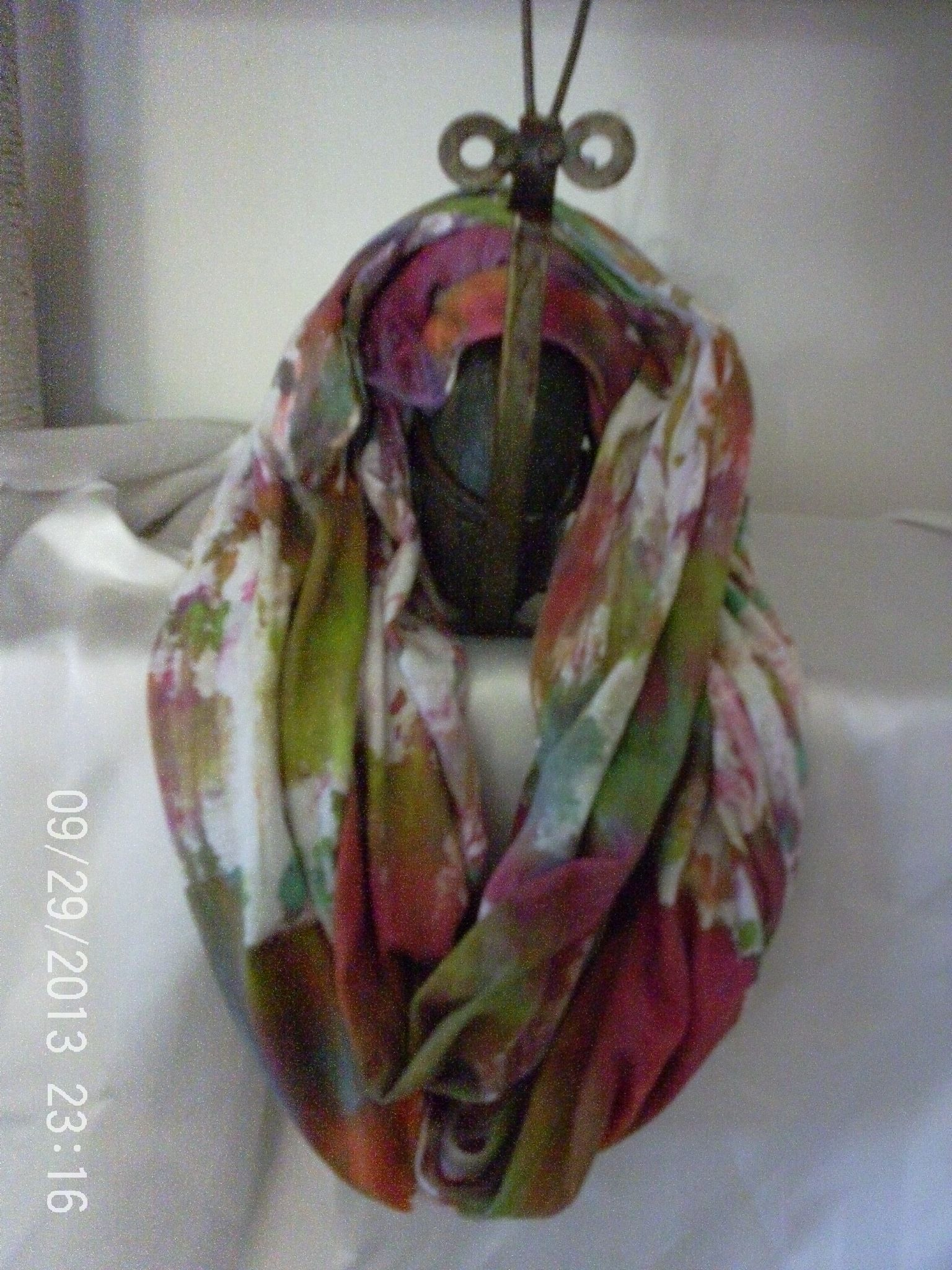 This is a soft jersey knit.  I hand dyed it to perk up any outfit......more pics can be found at etsy.pegilou3.....the colors are:  greens, purples, magentas, blues, white, orange, golds, and a small amount of grey. THIS SCARF IS SOLD