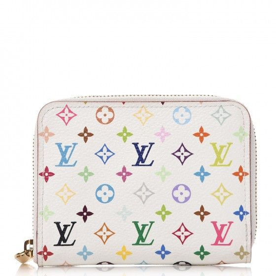 8063224a84f9 This is an authentic LOUIS VUITTON Multicolor Zippy Coin Purse Wallet in  Blanc White and Litchi. This fabulous wallet was designed in collaboration  with ...