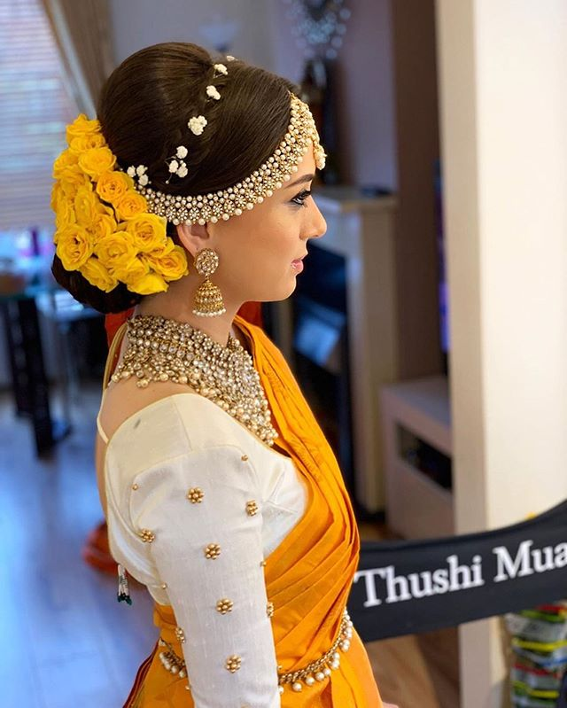Pretty South Indian Bride In Yellow Saree Hair And Makeup By Thushi Mua Yellow Roses Bridal Indian Bridal Hairstyles Indian Bride Hairstyle Indian Bridal