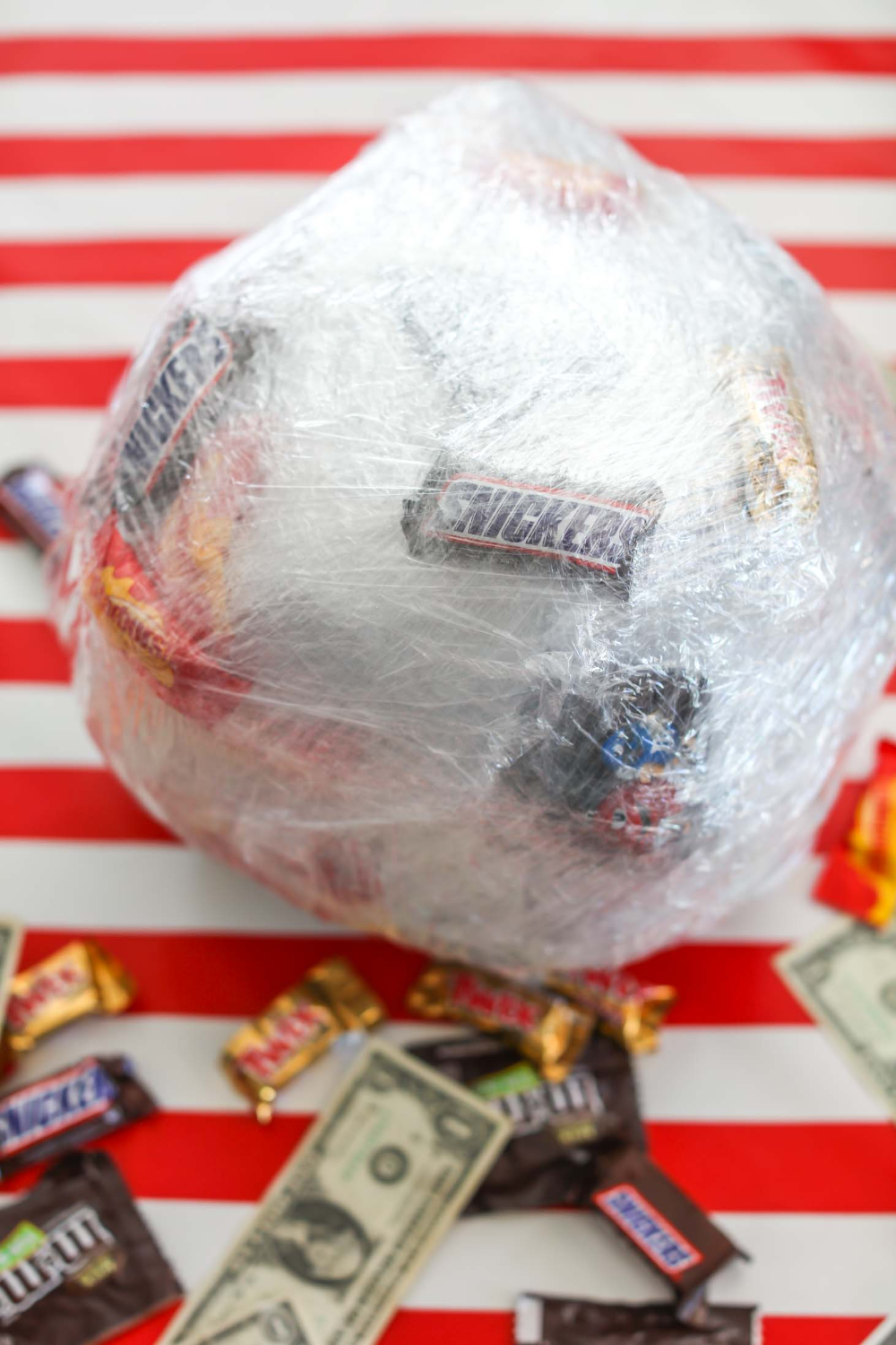 The Saran Wrap Ball Game - the most fun and entertaining holiday game out there. Guests get to unwrap a saran wrap ball filled with prizes and get to keep what comes out on their turn!