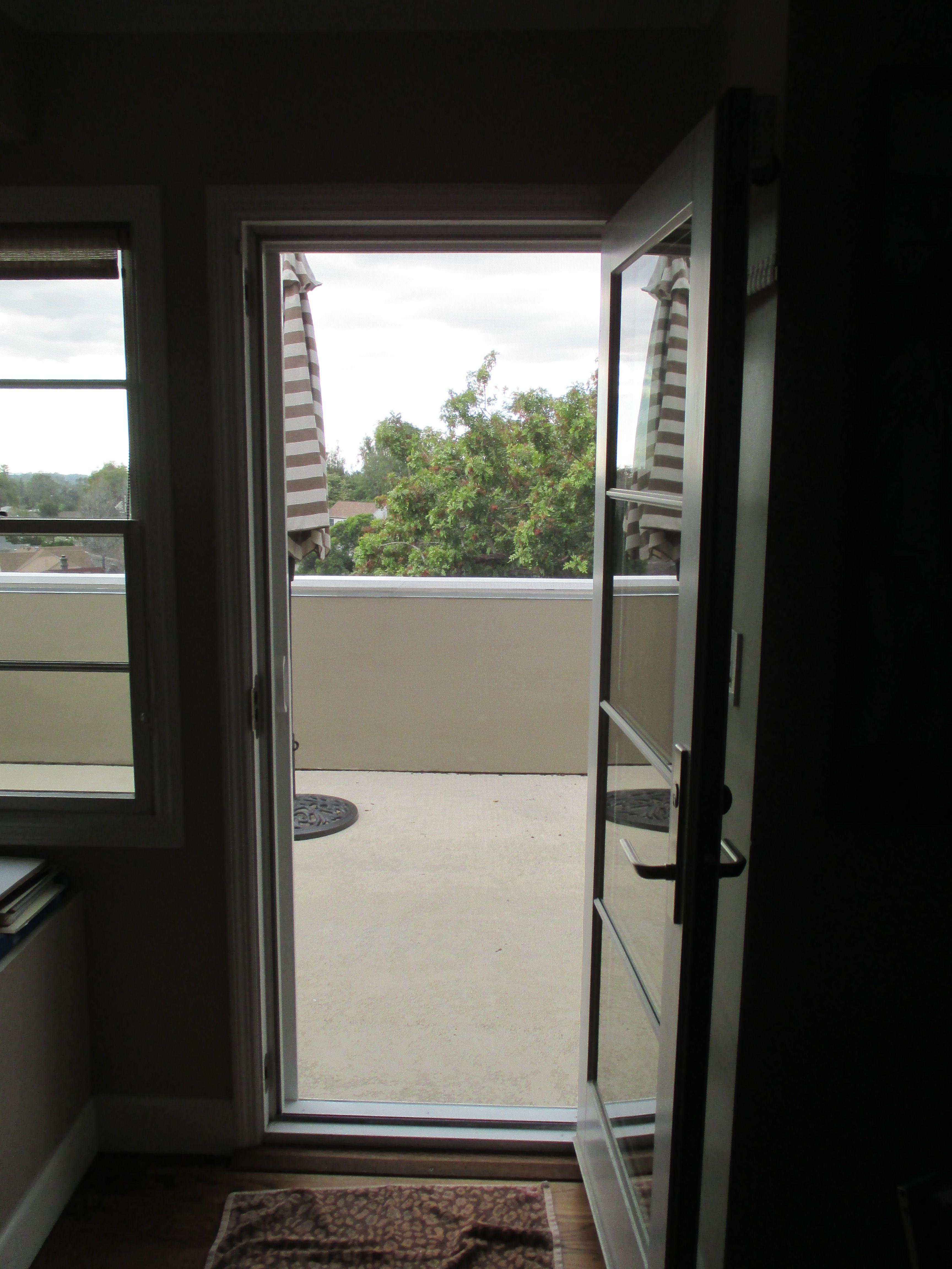 Single White Stowaway Retractable Screen Door With Black