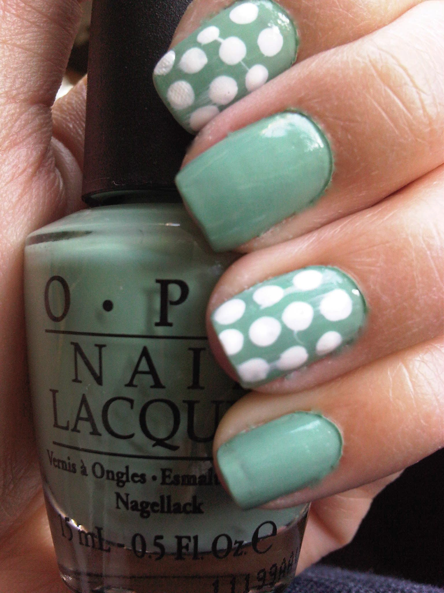 White on OPI - Mermaid's Tears. // the only thing I'm proud of about this is that I had the idea of breaking off the cotton of a Q-tip to use the stick as a dotting tool. Why are my polka dots so weird looking? .-.