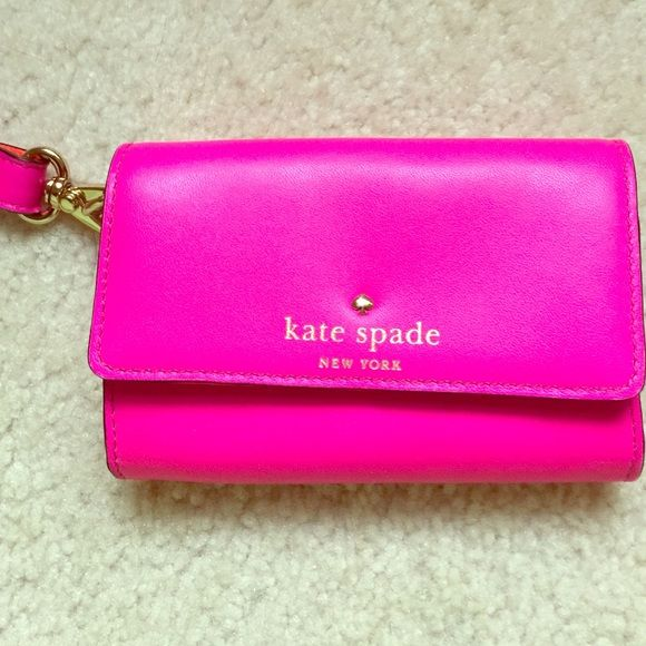 Kate Spade wallet In great condition!!!!! Only worn a couple times. kate spade Bags Wallets