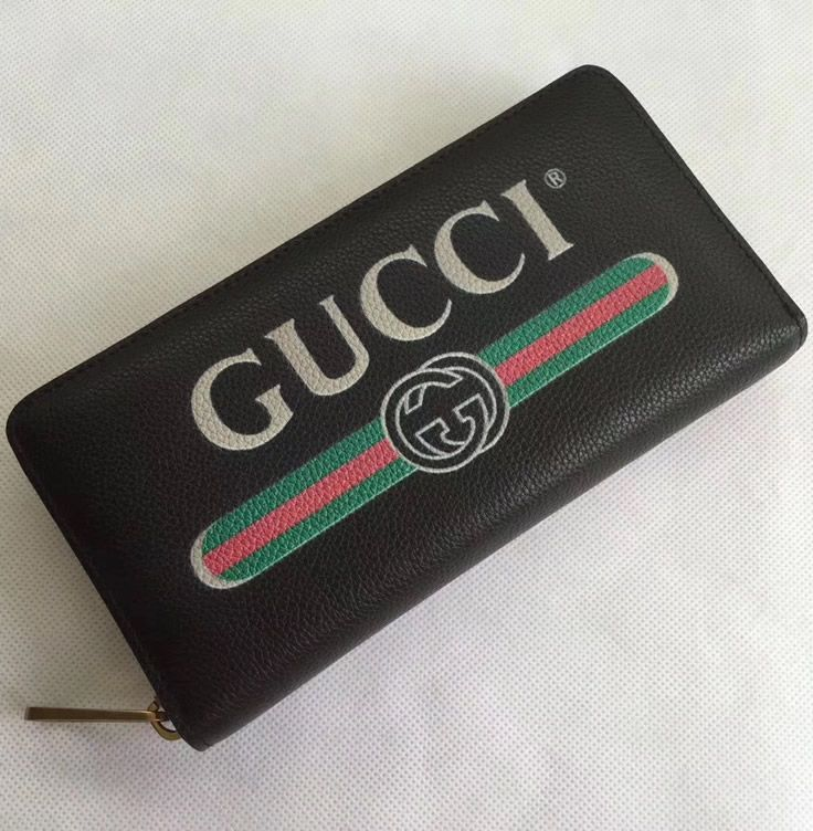 0e234be1f1a Inside you get 12 credit card slots and two massive compartments for cash  and bills. The entire Gucci Print Black leather zip around wallet is  optimized for ...