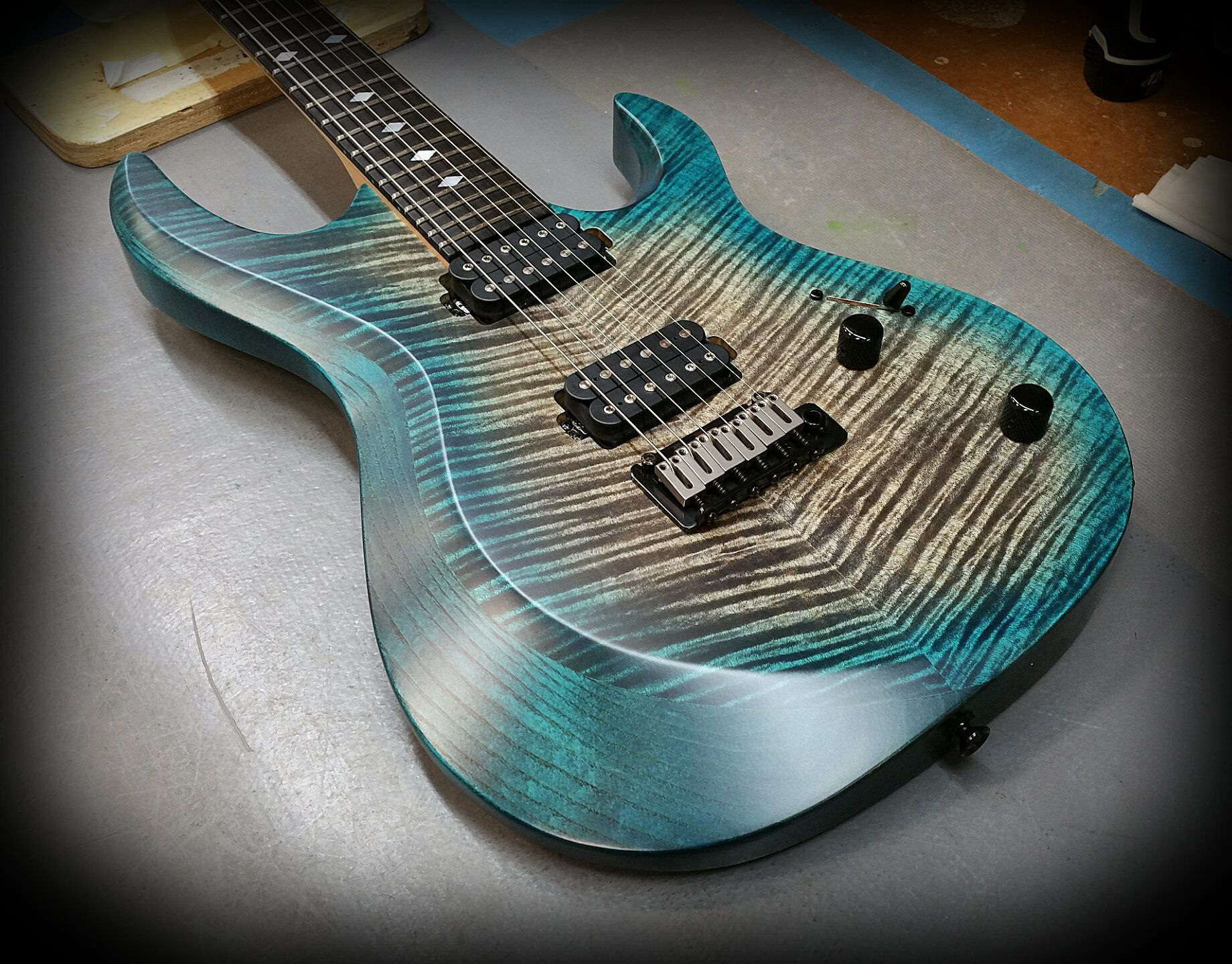 Kiesel A6 (Aries Model) Aqua Caliburst over flamed maple top with Kiesel Lithium Pick ups and vintage trem