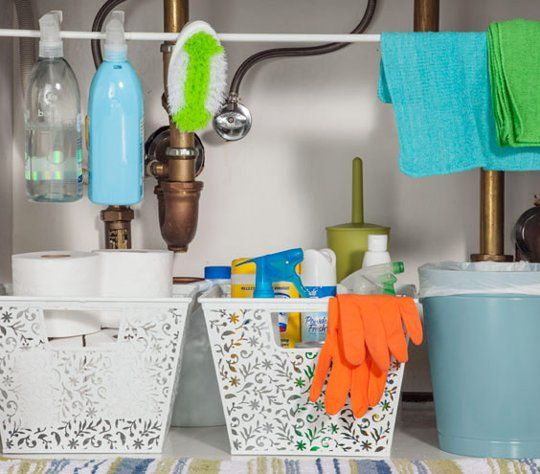 under-sink organization - tension rod to hang cleaning stuff! brilliant!