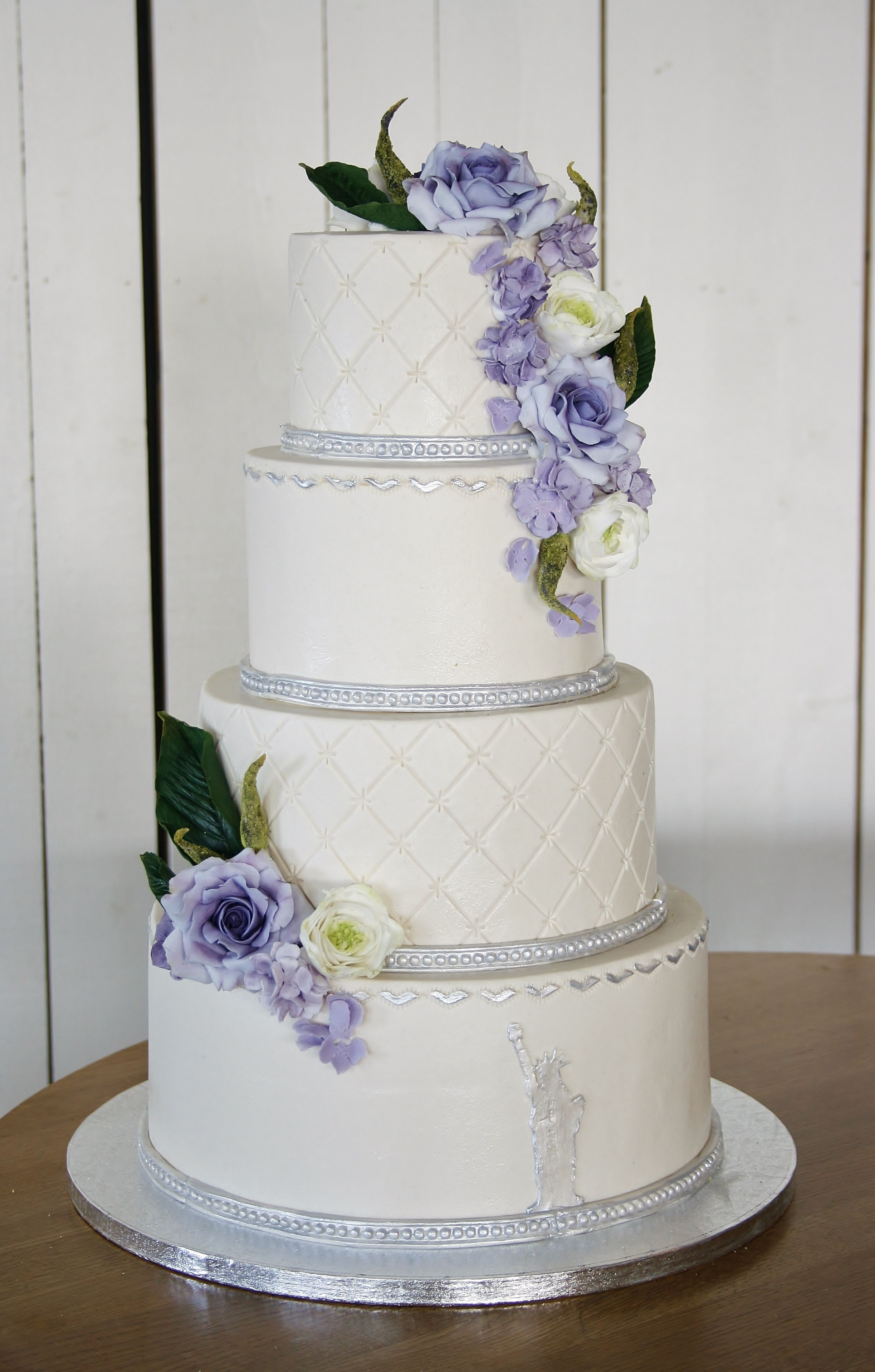 Wedding cake in lilac ,green, white and silver decorated with ...