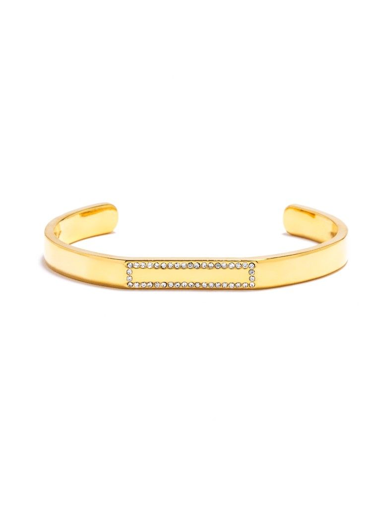 A crystalline border on a stackable solid metallic cuff adds a sophisticated touch of sparkle.