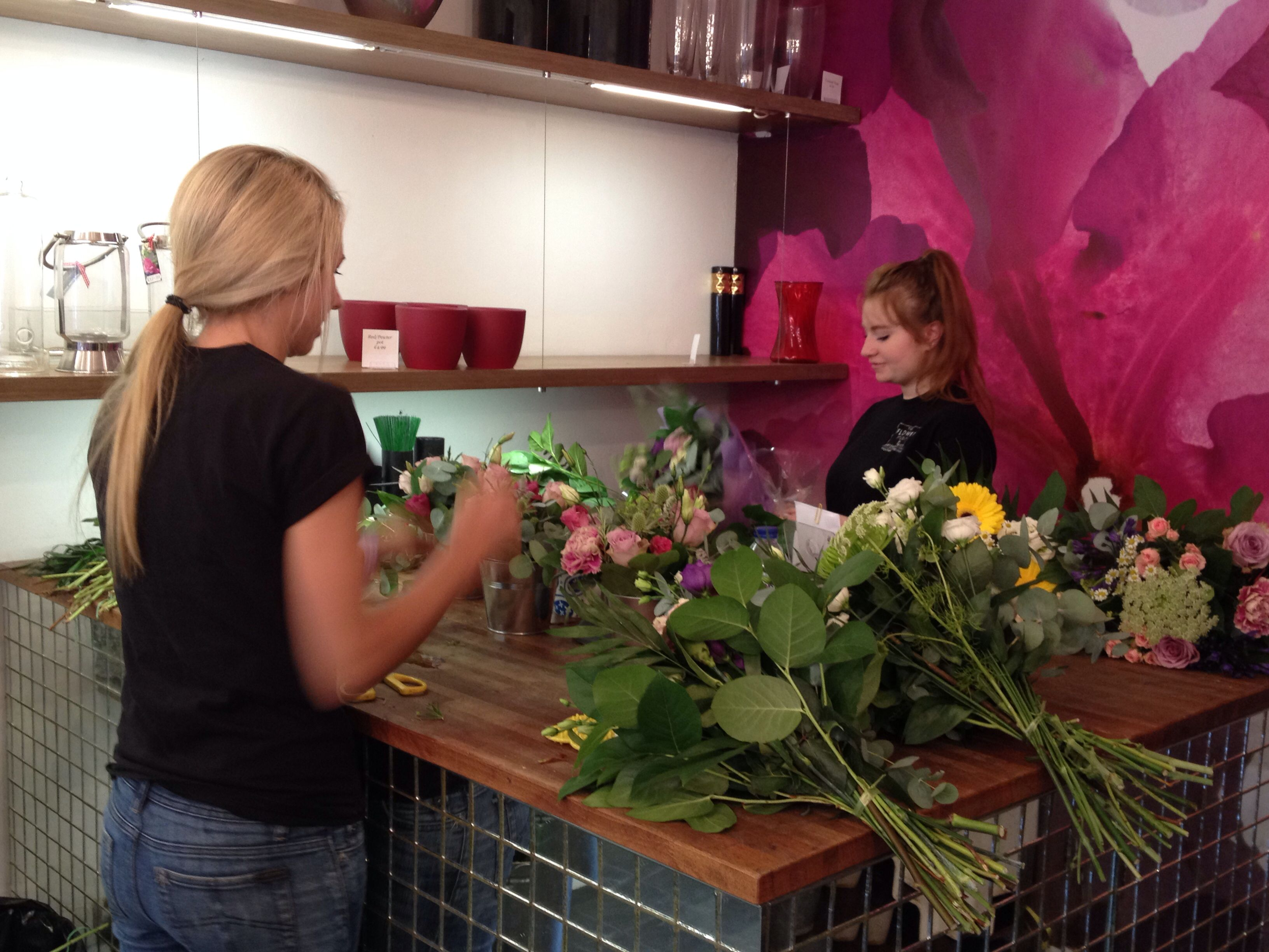 Shop Manager Lisa and florista Nadia working at the floristry table in the shop
