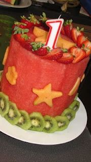 All Fruit Cake ~it's a solid cylinder of watermelon, with other fruit to decorate and biscuit cutters to cut out the shapes. Great way to celebrate without so many calories!