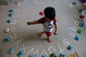 masking tape letters on the floor.  (Also have beginning word sounds to learn letter blends with the same idea of matching objects or words with pictures.)