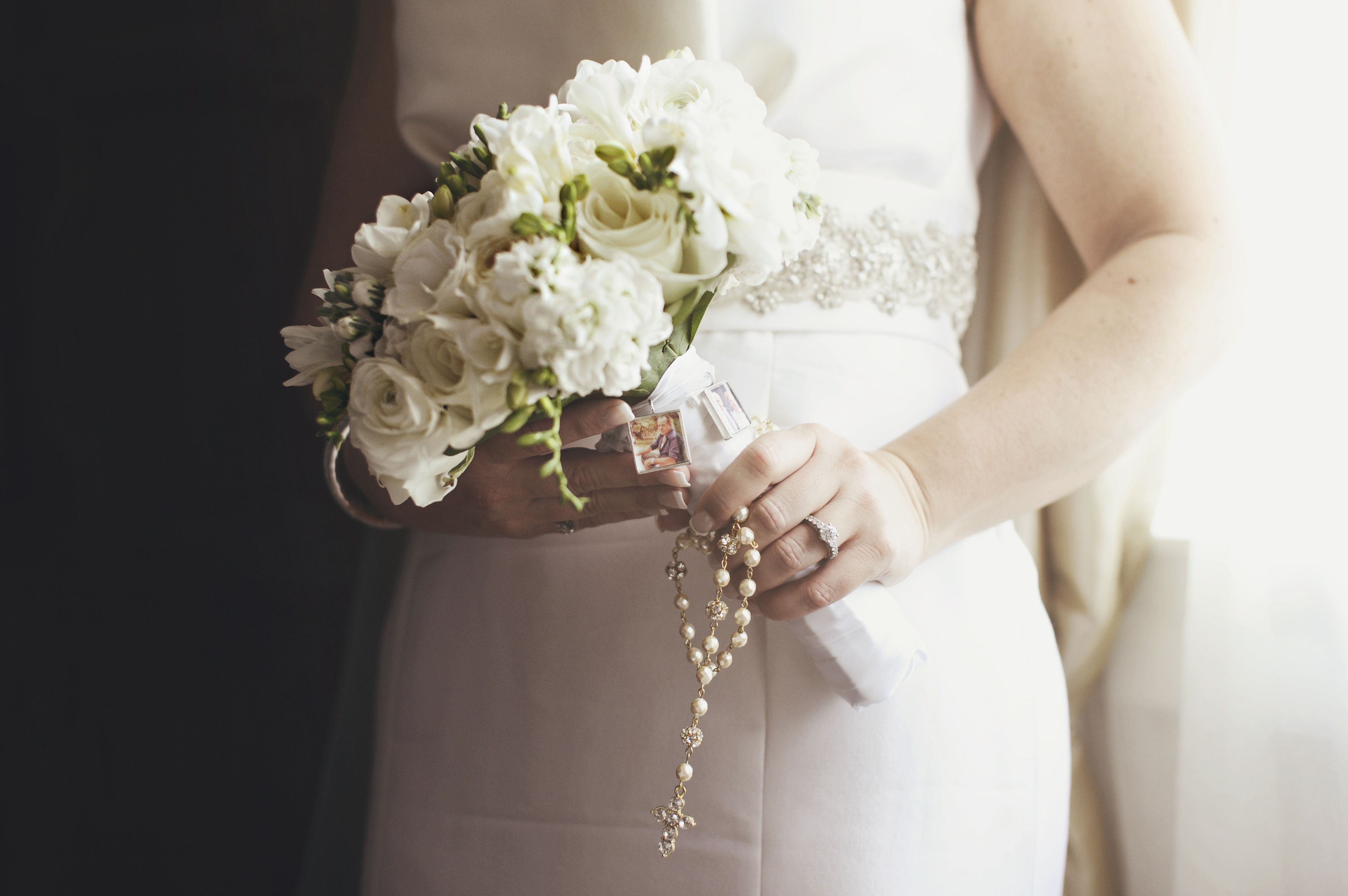 A Classic Bridal Bouquet Strung With An Image Of A Family Member