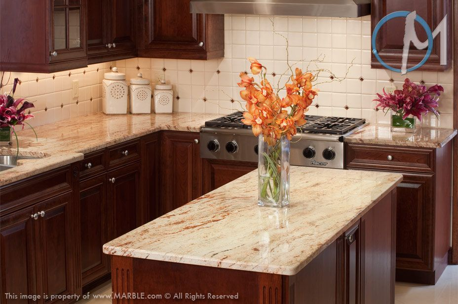 Ivory brown granite a light ivory colored stone with for Peach kitchen ideas
