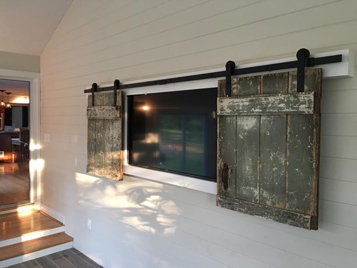 Rustic Barn Doors Used To Hide Wall Mounted Tv On Ship Lap