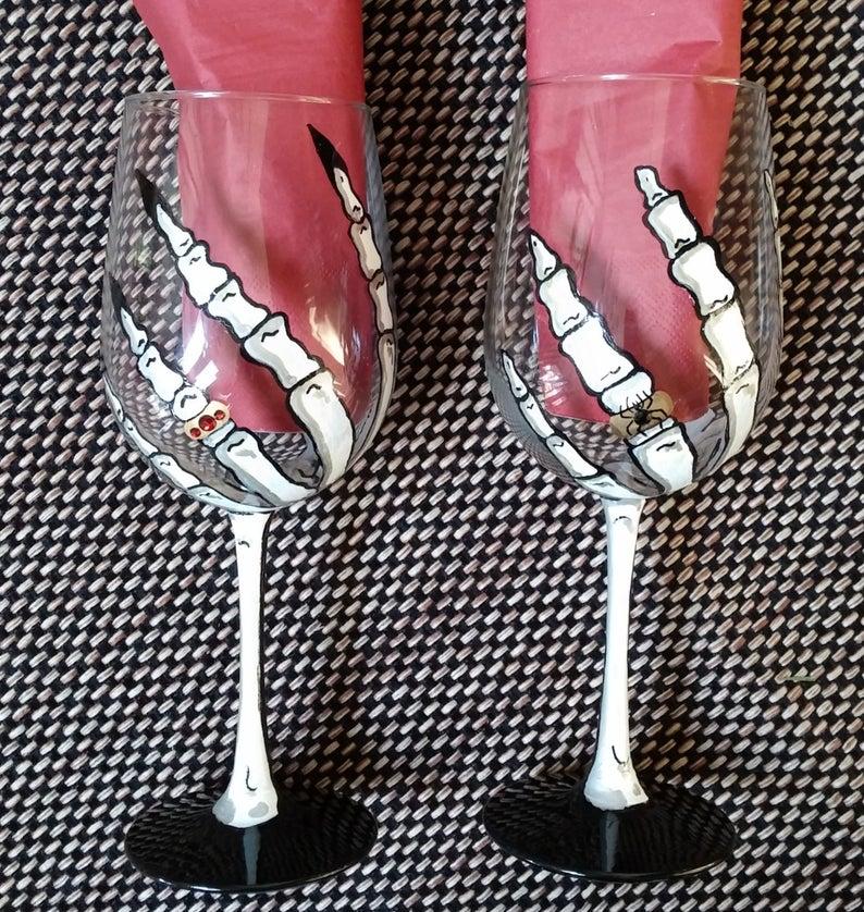 Skeleton hand Halloween hand painted wine glasses. Etsy