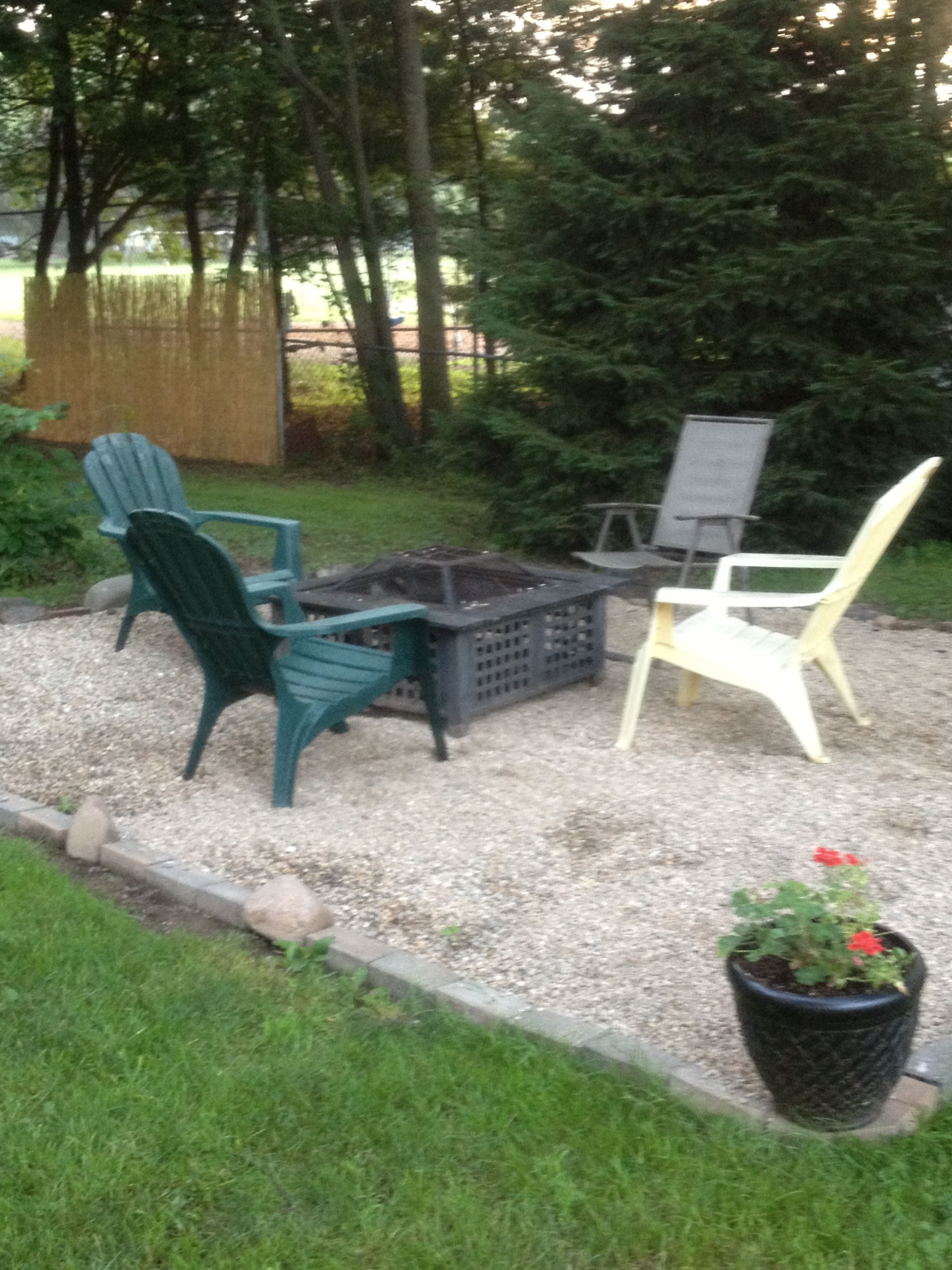 14x14 fire pit area complete! Used rocks and bricks from around the yard for the perimeter and about 1 1/2 yards of gravel for a base of about 2-3 inches deep.