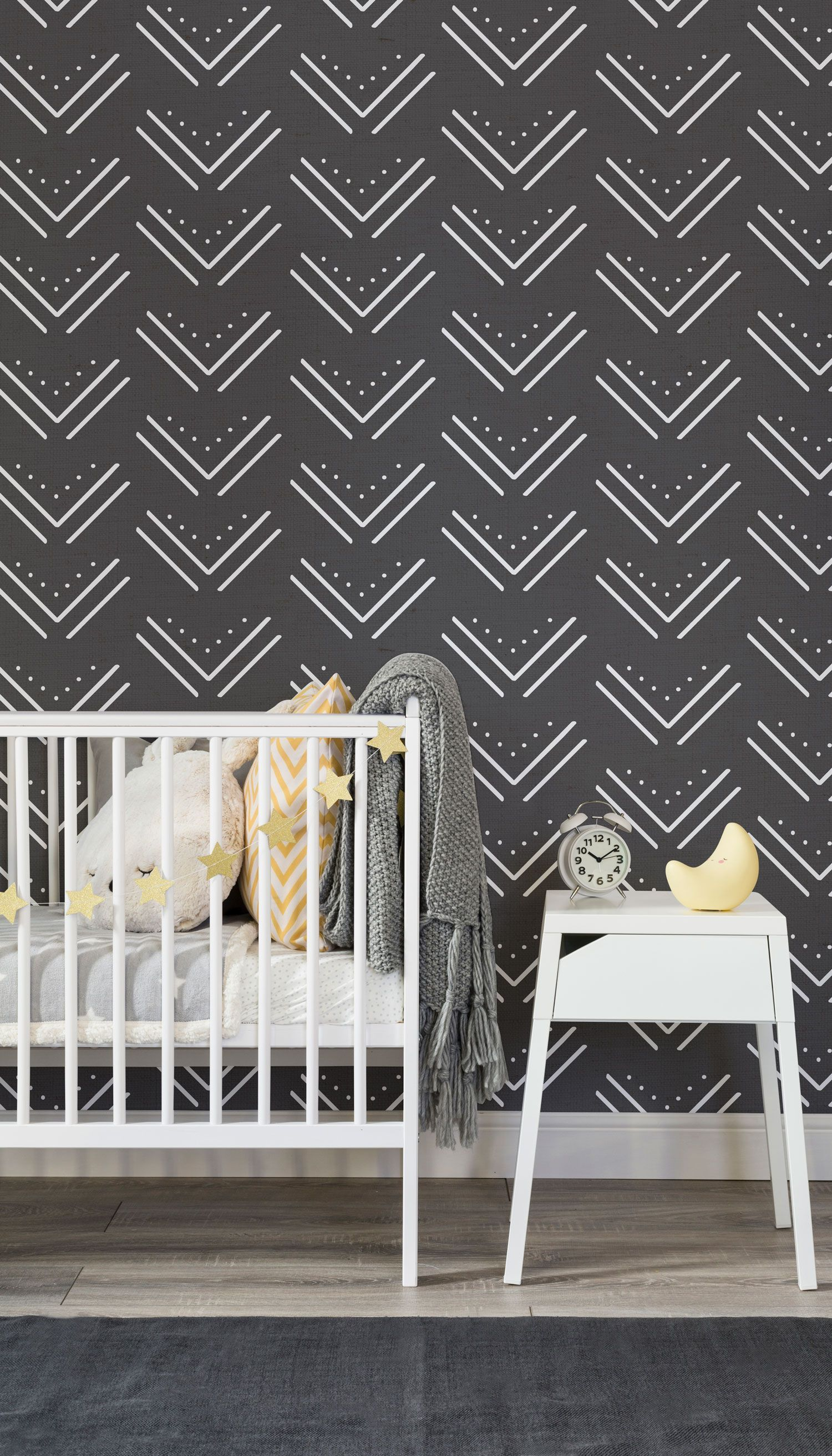 On the lookout for nursery wallpaper ideas this tribal inspired wallpaper design combines a decorative repeated pattern with a monochrome palette
