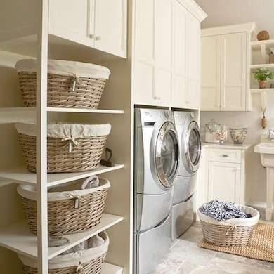 Storage space is abundant in this laundry room, thanks to the cabinets, baskets, and plenty of shelves.