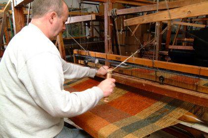 Weaver at work at his loom, Studio Donegal, Kilcar, Donegal, IE