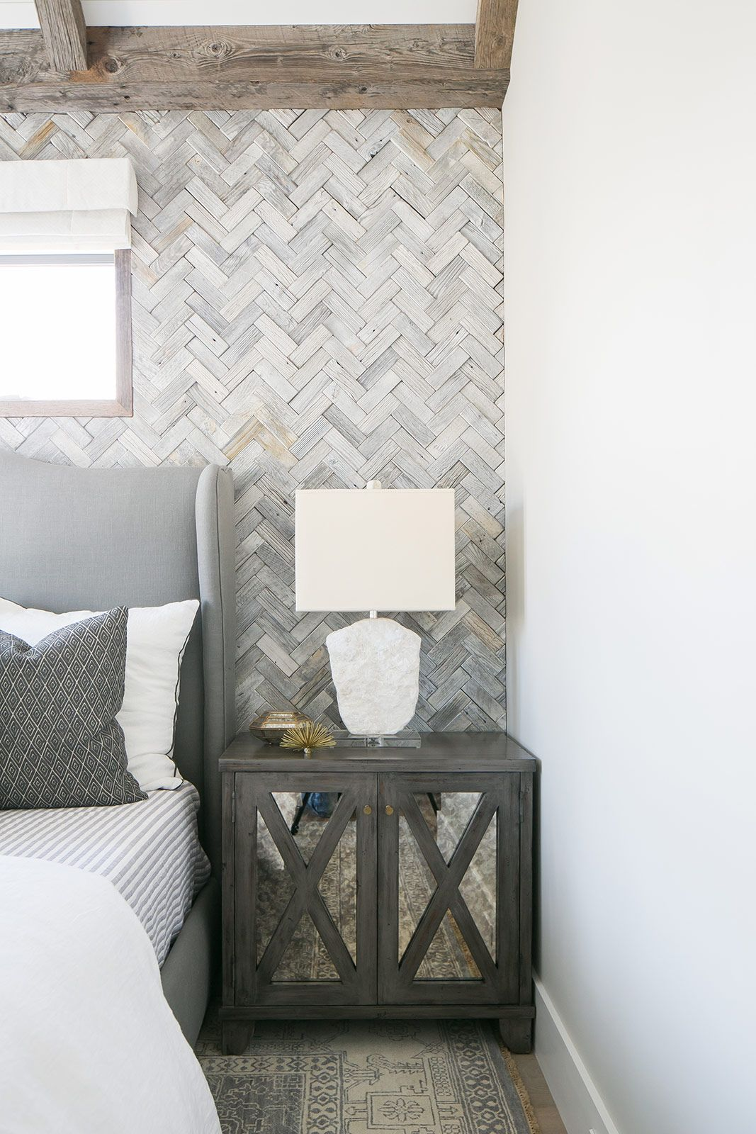 Marigold image 21 brooke wagner design herringbone tile wall rustic wood mirrored nightstand grey linen headboard fabulous