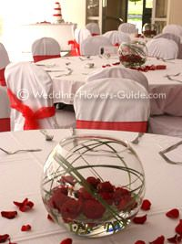 Red rose low centerpiece in goldfish bowl | All Things Bright and ...