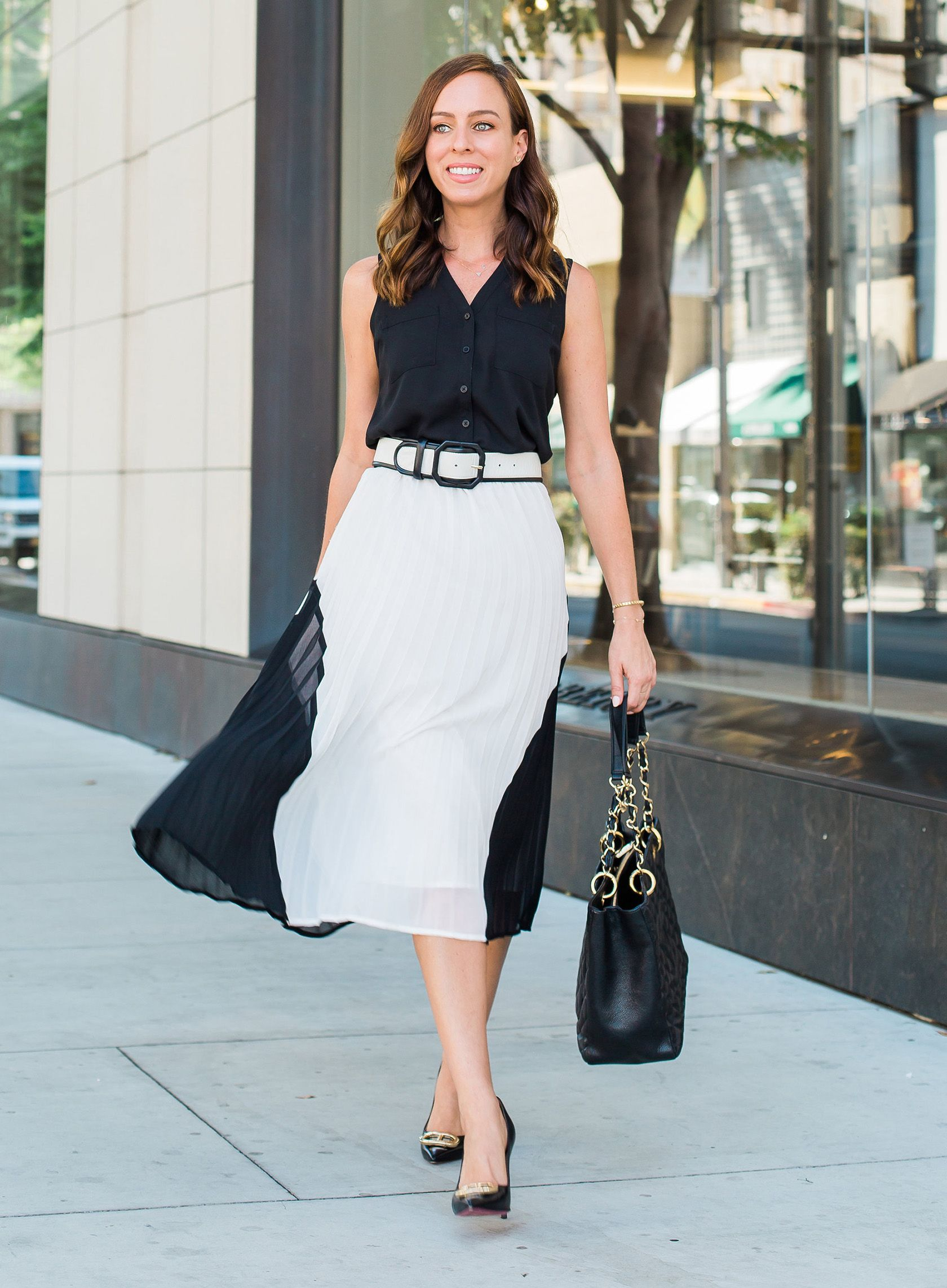 daaf9817e6c Sydne Style shows black and white outfit ideas inspired by meghan markle  pleated dress  blackandwhite  skirts  meghanmarkle  classic