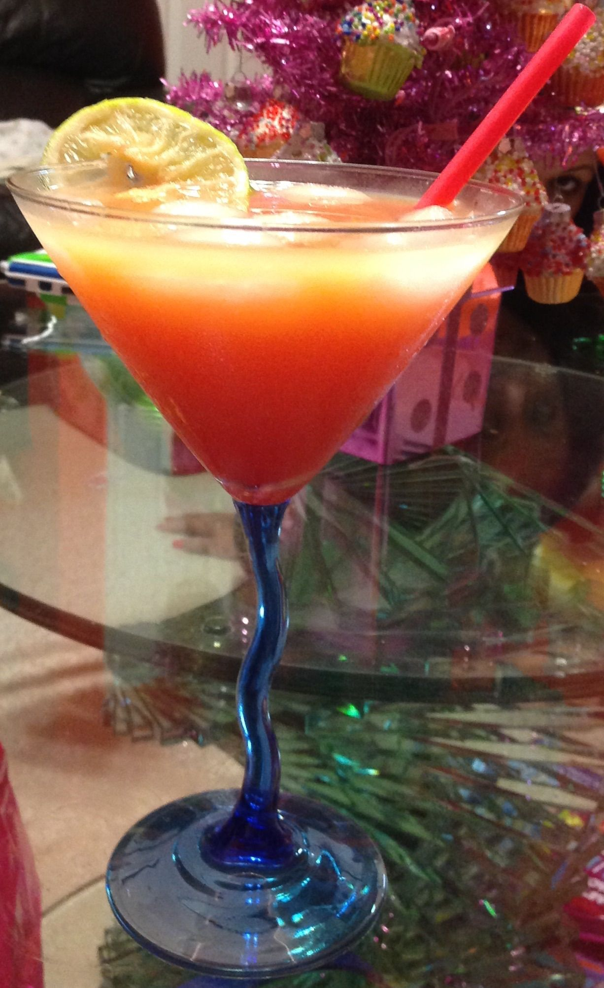 Mango orange tequila sunrise    1oz tequila  1/2oz Orange curacao   1/2oz triple sec  2oz Orange mango juice Splash of grenadine