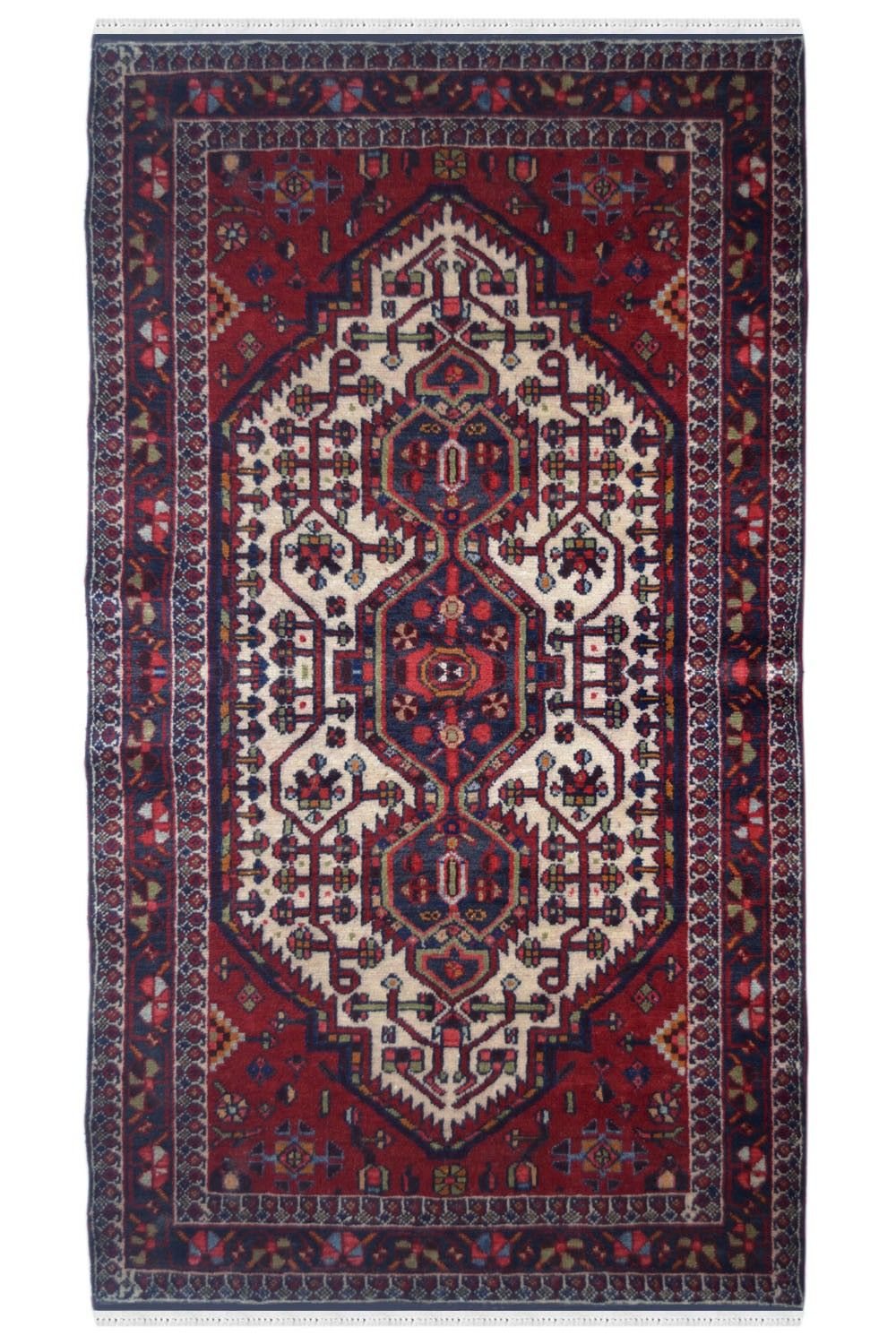 Antique maroon rug with bold motifs and bright colors