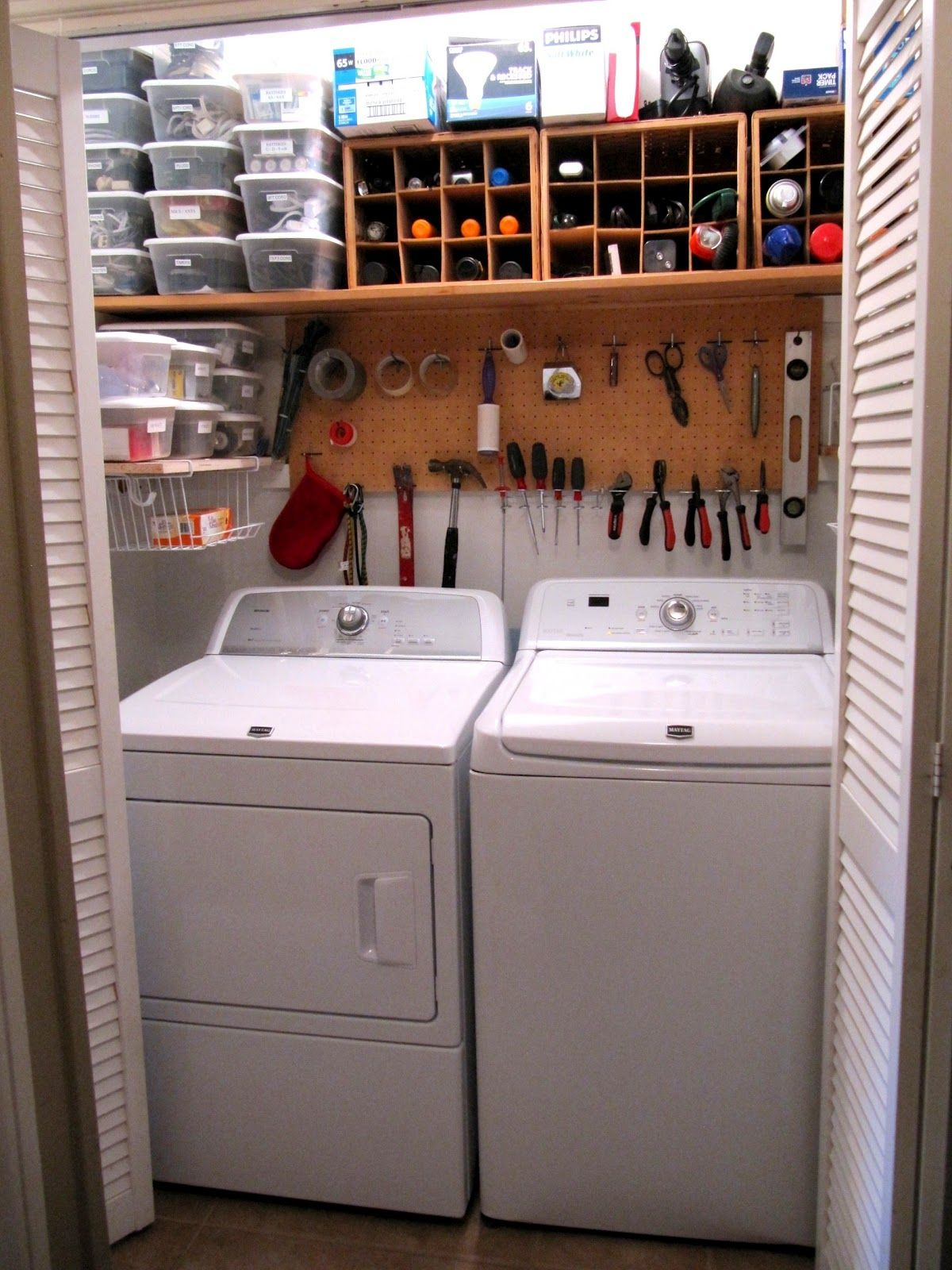 "LAUNDRY Room organization Top shelf ""Junk Drawer"" items The far left plastic boxes middle wooden wine bottle boxes"