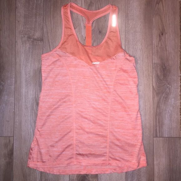 Reebok athletic racerback tank top Reebok athletic racerback tank top. Size medium. 100% polyester. Has reflective spots on it - great for any CrossFit WOD or running or any workout! The first picture shows the reflective size tag from the inside showing through just from the flash. Top front of shirt is a mesh type material.  I consider this to be sort of orange/peach in color  Reebok Tops Tank Tops