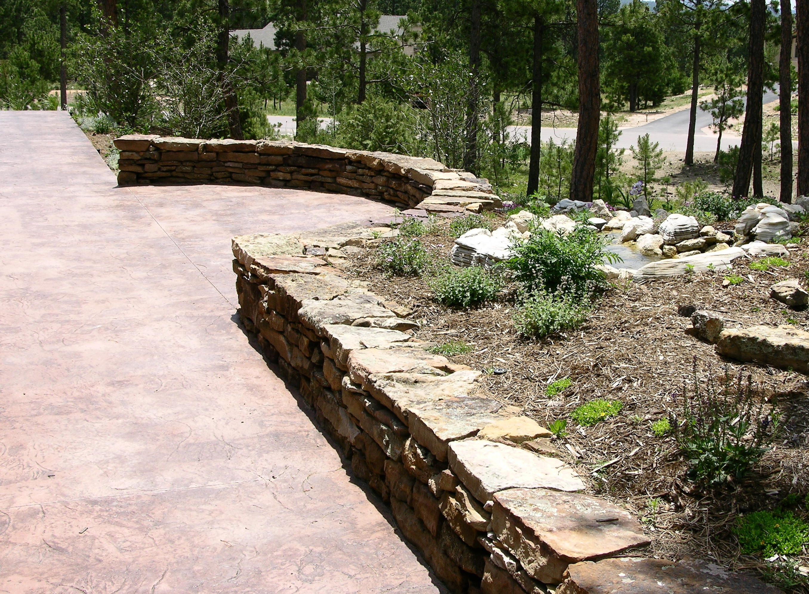 Moss rock patio seatwall The materials are a natural moss rock