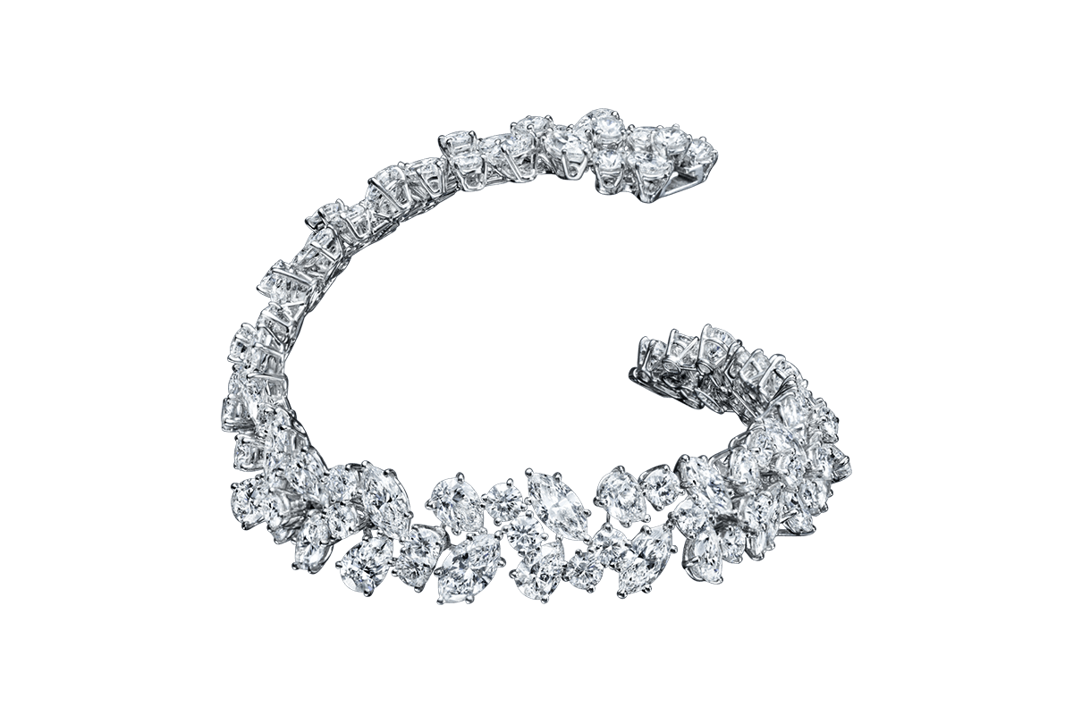 One of the House's most iconic jewelry designs, the Winston Cluster is the ultimate embodiment of timeless glamour, and unsurpassable style. These exquisite jewels feature round brilliant, pear and marquise-shaped diamonds set with minimal metal and at varying angles, resulting in a cluster of remarkable brilliance that is synonymous with Harry Winston. 88 marquise, pear-shaped and round brilliant diamonds weighing a total of approximately 30.21 carats, set in platinum.