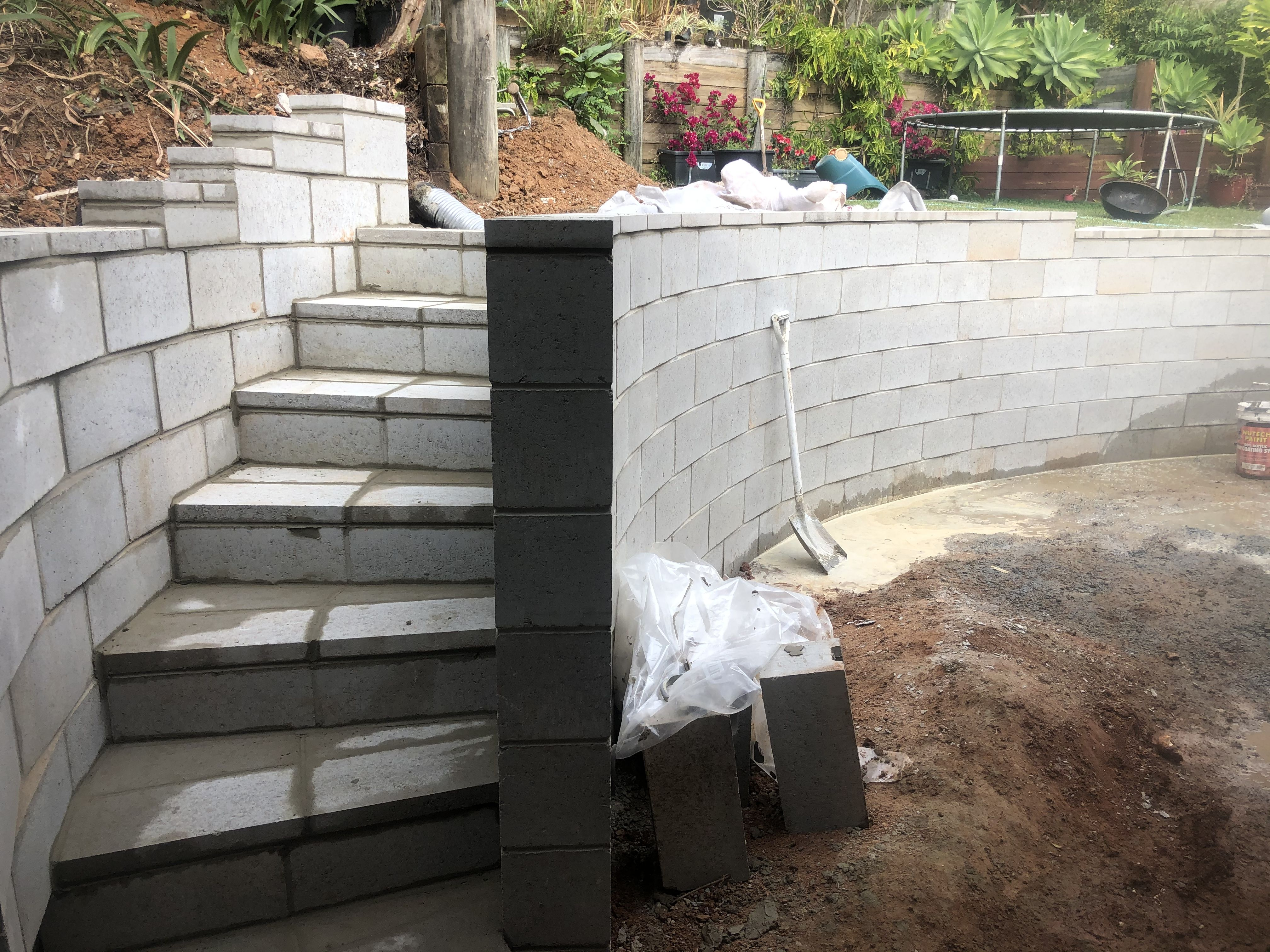 Curved Concrete Block Retaining Wall With Steps Landscaping