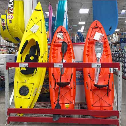 High Quality One Of A Series, Here Sit On Top U0026 Sit Inside Recreational Kayaks Are  Displayed Standing Corralled By Struts As A Kayak Pallet Rack Vertical  Display