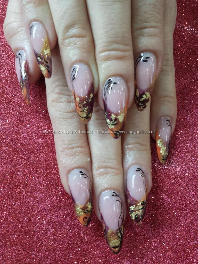 Multi coloured autumn gel polish with gold leaf and freehand nail ...