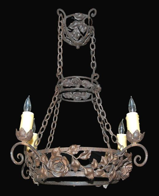 Ornate Iron Ring Chandelier: An Ornate French Wrought Iron Chandelier From The Late